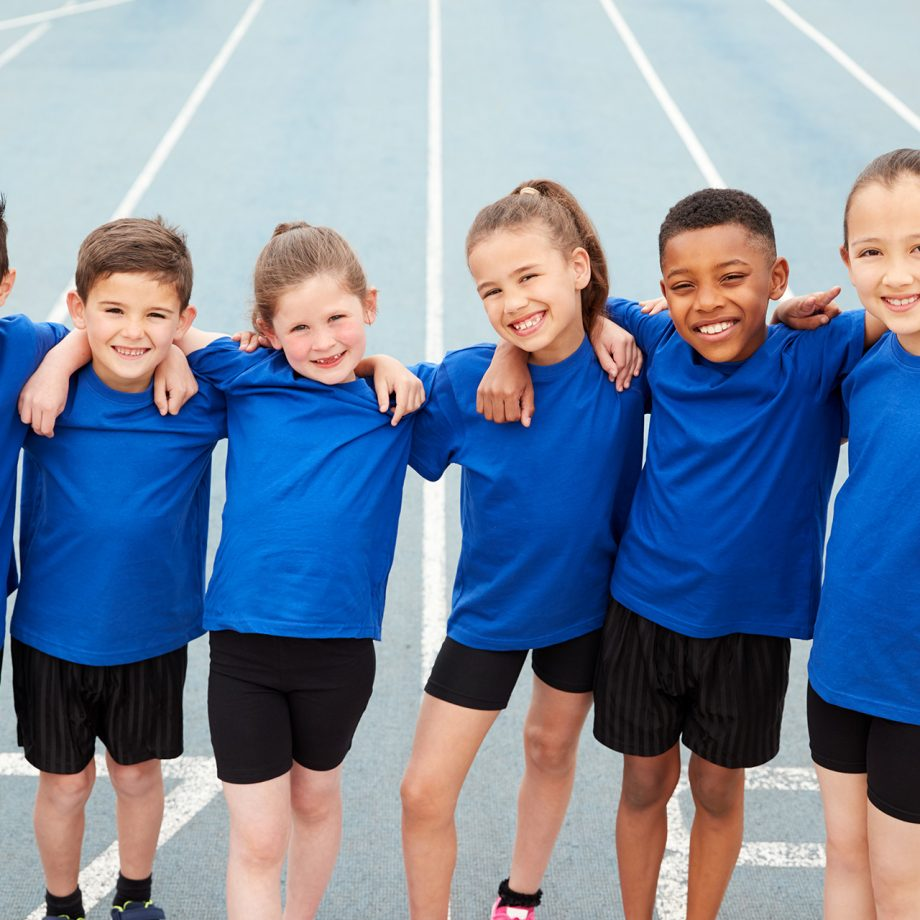 portrait-of-children-in-athletics-team-on-track-on-YWUGFEZ